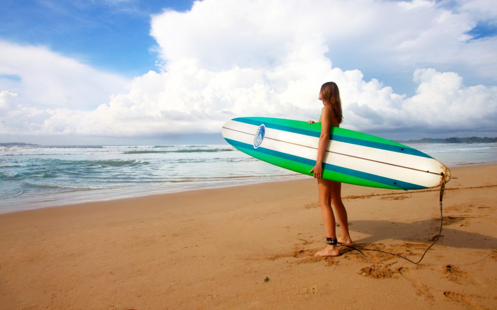 solo female surfer traveler