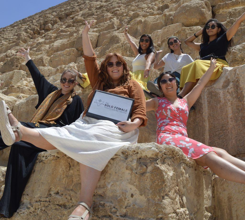Women sitting on Pyramid