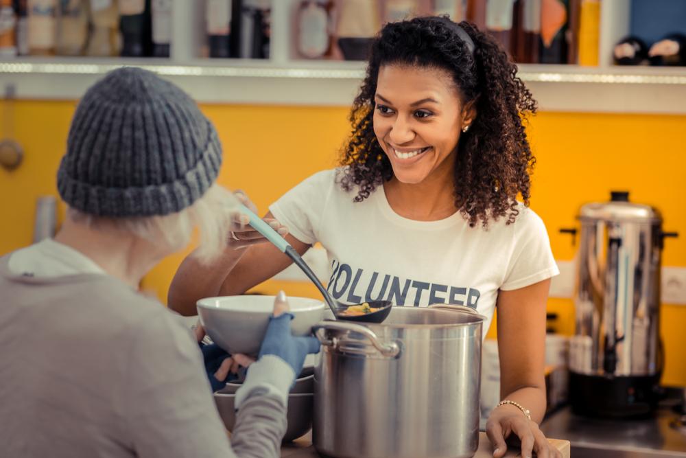 woman volunteering serving food