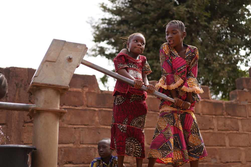 girls pumping water