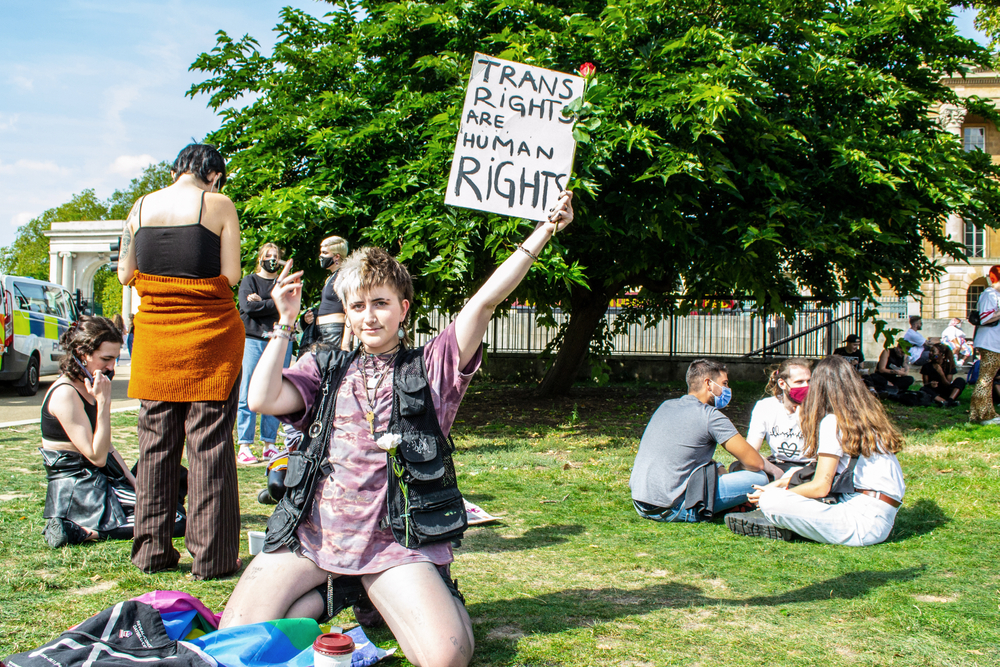 traveler in park with queer rights sign