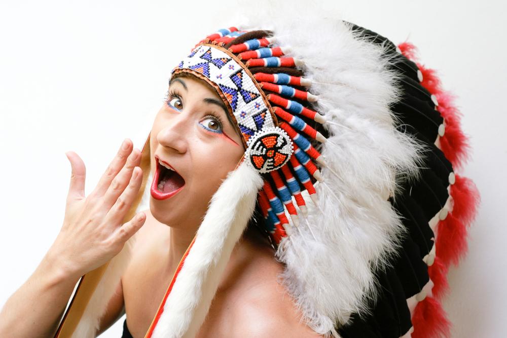 woman wearing Native American headl dress