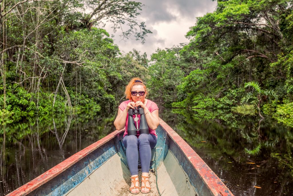 woman in a canoe in the amazon