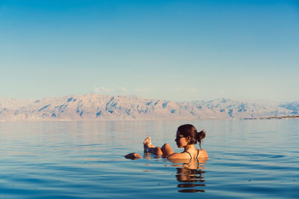 Girl in Dead Sea floating