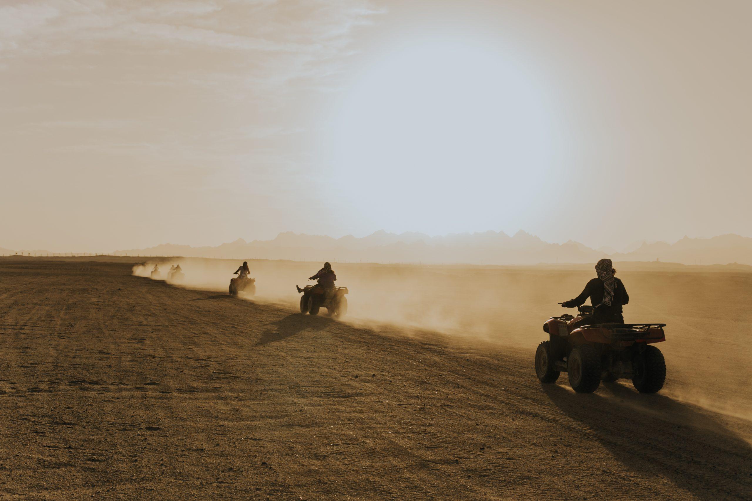 women riding ATV