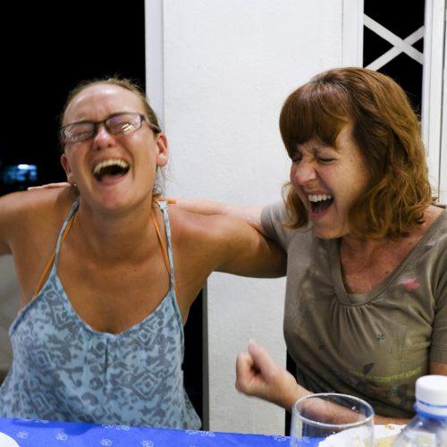 women laughing in Cuba