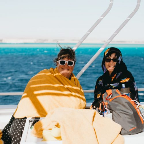women on a boat smiling